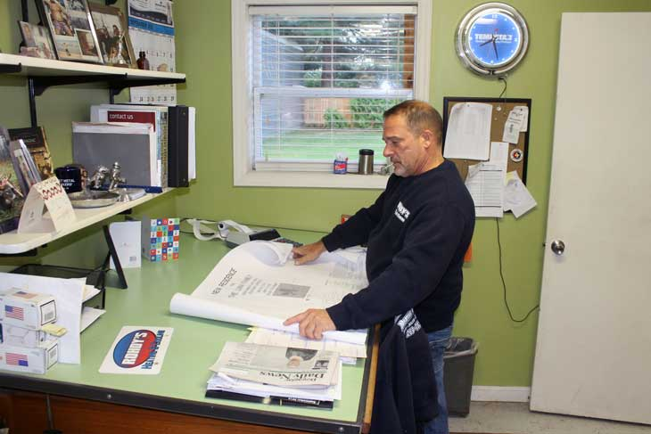 Photo of owner Chris Rohdy reviewing intallation plans.